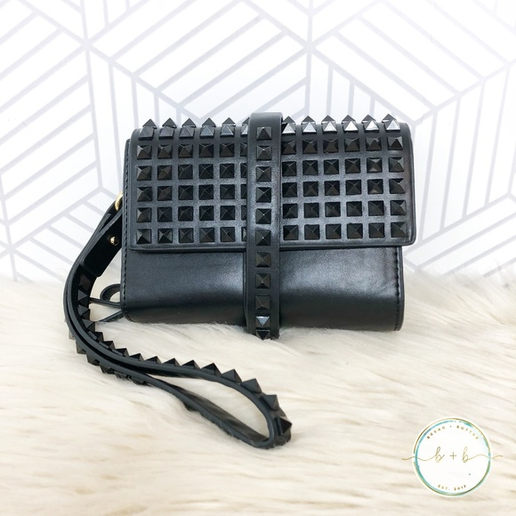 e2ebd1e9645 Zara Black Studded Leather Clutch Wristlet. M_5b8722d09539f7ffc32abef5